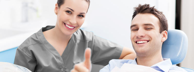 dental patient relieved thumbs up