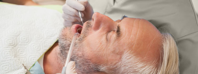 man with eyes shut getting sedation dentistry services